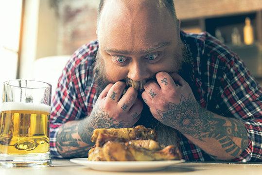 Man staring at food