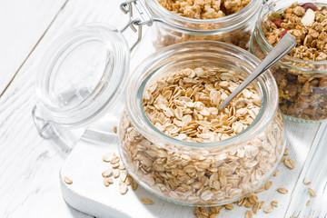 oat flakes and assortment of muesli, closeup top view