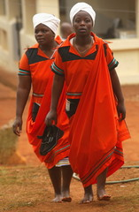 WOMEN CARRY SHOES AT THE INNAUGURATION OF MAKOBO MODJADJI AS RAINQUEEN.