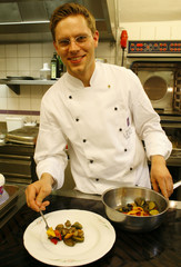Andre Brauner, maitre de la cuisine of  Schlosshotel Lerbach hotel prepares a first course plate in ..