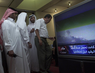 QATARI SECURITY MEN WATCH T.V. IN THE HALL OF THE SHIRATON DOHA IN THEFORTH DAY OFTHE WTO CONFERENCE ...