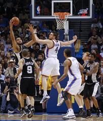 San Antonio Spurs center Duncan rebounds against Oklahoma City Thunder center Collison during their NBA basketball game in Oklahoma City