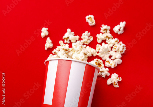 popcorn in red and white cardboard box popcorn border isolated on