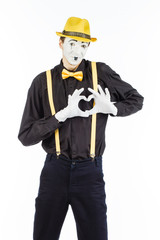 Portrait of a man, artist,clown, MIME. Shows a heart isolated on white background.