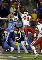 Chiefs Warfield deflects ball from Titans Bennett in NFL action in Nashville.