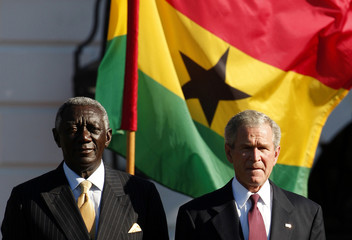 U.S. President Bush and Ghana's President Kufuor take part in welcoming ceremony on the South Lawn of the White House in Washington