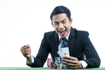 The gambler is very happy to win poker cards and recieve bet a large stack