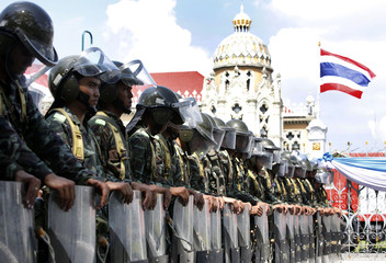 Soldiers stand guard outside Government House in Bangkok