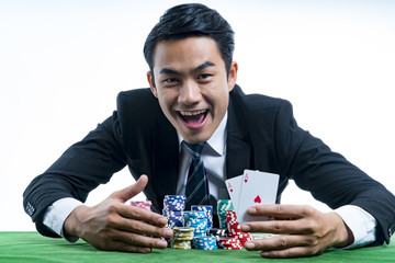The poker gambler showing a pair of aces and hold bet a large stack with arms