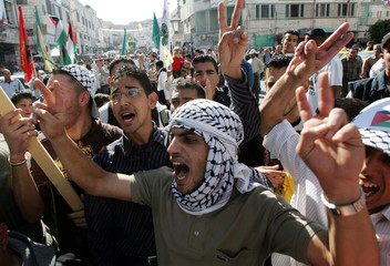 Palestinians chant slogans during a rally in Jenin