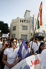 Bollywood actress Diya Mirja walks with students during a protest rally against politicians in Mumbai