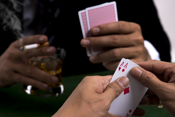 The pair of aces in poker player hand