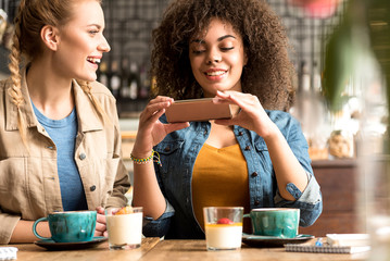 Outgoing girls making conversation at table