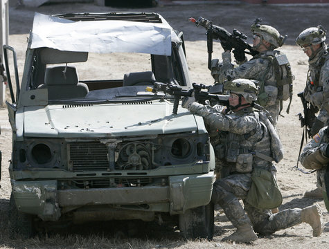 U.S. Marines equipped with Multiple Integrated Laser Engagement System (MILES) are pictured during a Force-on-Force military operation at the U.S. army's Rodriguez range in Pocheon