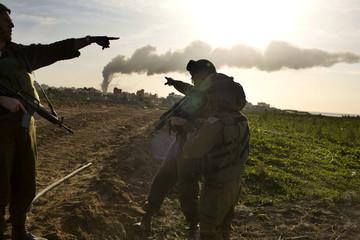 Israeli soldiers stand near Atatra in northern Gaza Strip