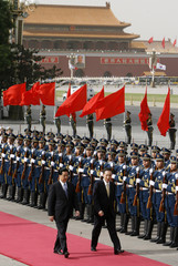 Chinese President Hu and visiting South Korean President Lee review the honour guard during a welcome ceremony at the Great Hall of the People in Beijing