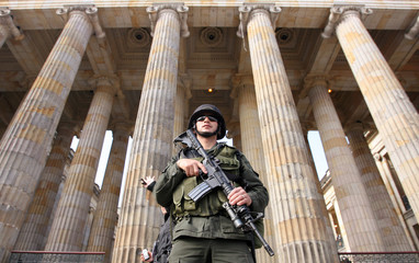 Colombian policeman stands guard in front of Congress building in Bogota