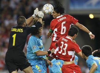 Meira of VfB Stuttgart challenges Valdes of Barcelona during their Champions League Group E match in Stuttgart