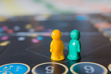Multi-colored chips for tabletop game in the form of little men