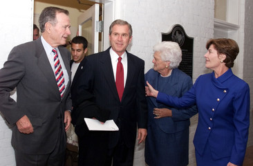 Texas Governor and Republican presidential candidate George W. Bush (2nd L) emerges from the Governo..