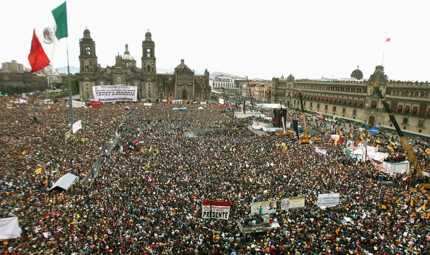 """Supporters of Andres Manuel Lopez Obrador attend his swearing in ceremony as """"legitimate president""""  at Mexico City's Zocalo square"""