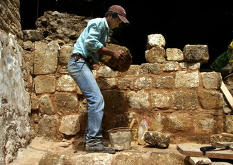- PHOTO TAKEN 17APR04 - A local Q'eqchi indian reconstructs part an ancient Mayan palace at an archa..