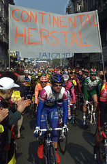 CYCLISTS RIDE UNDER A BANNER OF BELGIAN FACTORY OF TYRES MAKER CONTINENTAL AT THE START OF THE ...