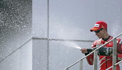 Ducati MotoGP rider Casey Stoner of Australia celebrates after winning the Malaysian Motorcycle Grand Prix in Sepang