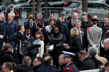 Sibeth Ndiaye, press attache of French President-elect Emmanuel Macron, and staff members of outgoing French President Francois Hollande attend a ceremony at the Arc de Triomphe in Paris