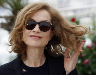 Jury president Huppert poses during a photocall in Cannes
