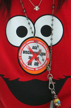 Flight attendant wears protest sticker on her shirt at Hong Kong international airport