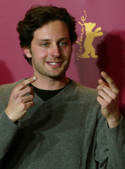 Italian actor Fillipo Trojano poses during a photocall for the film 'Tickets' at the 55th Berlinale ..