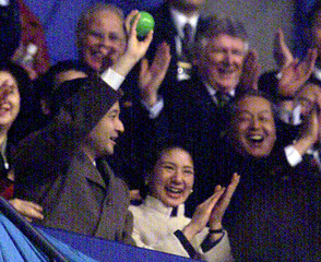 CROWN PRINCE NARUHITO CATCHES BALL THROWN BY SKATER IIN NAGANO.