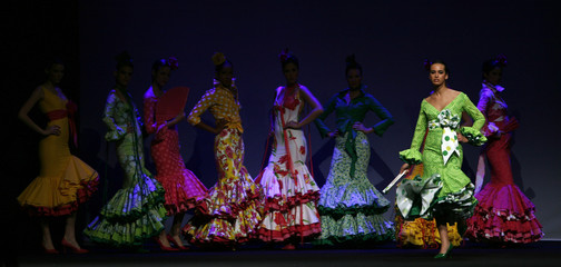 Models present creations from Rafael Gonzalez Valverde during the International Flamenco Fashion Show in Seville