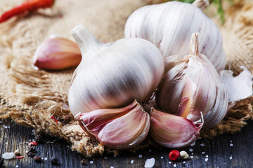 Fresh garlic, sea salt, pepper and spices, rustic style, selective focus