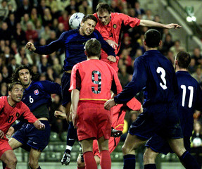 PETRAS OF SLOVAKIA JUMPS FOR THE BALL WITH CLEMENT DURING THEIRFRIENDLY MATCH IN BRUSSELS.