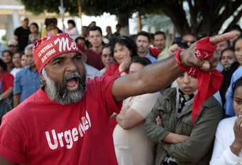 A supporter of Honduras' ousted President Zelaya shouts next to other supporters as they take part in a rally outside the National Congress building in Tegucigalpa