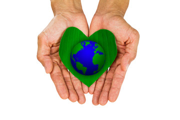 Man's hands holding heart shaped green leaf with earth on white background, environment concept