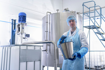 Worker using mixing plant in pharmaceutical factory