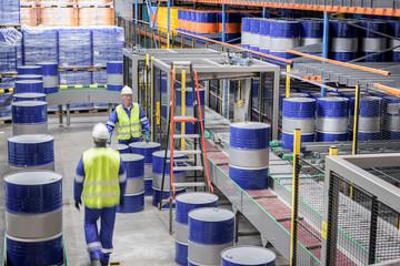 Oil barrels in robotic storage in oil blending factory