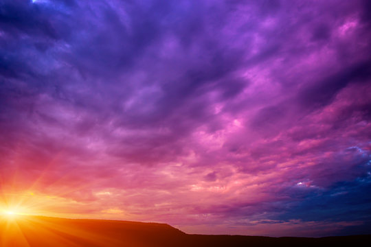 Photo of a violet sunset with clouds