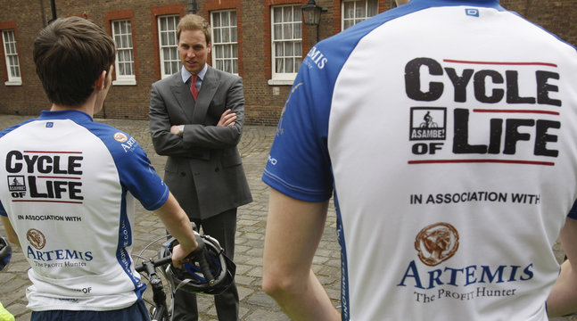 """Britain's Prince William talks to members of the """"Cycle of Life"""" team at Clarence House in London"""