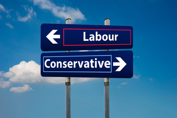 two road signs representing labour and conservative parties in uk early elections in june