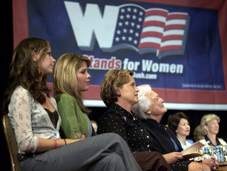 President George W. Bush family members, daughters Barbara and Jenna (L and 2nd from L), sit with th..