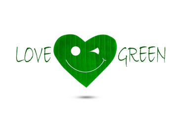 Text love green with green smiling heart shaped leaf on white background, environment concept