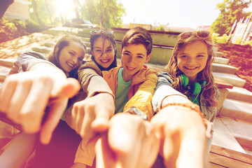 teenage friends or students pointing finger at you Wall mural