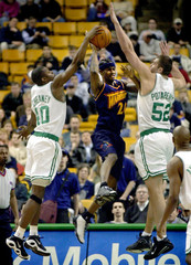 WARRIORS CAFFEY TRAPPED IN CELTICS DOUBLE TEAM.