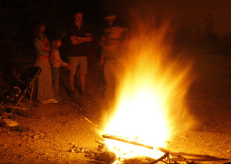 People stand around a bonfire during Lag Ba-Omer festivities in Jerusalem