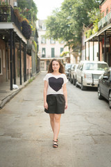 Woman walking in street, French Quarter, New Orleans, Louisiana, USA