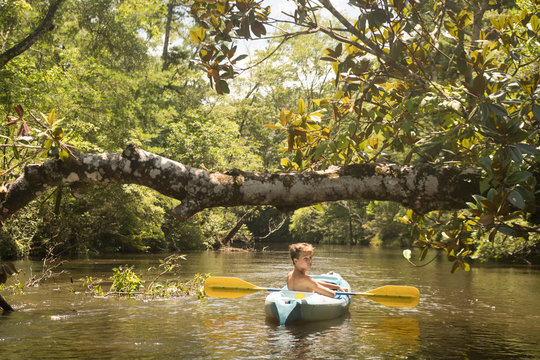 Teenage boy in kayak, Econfina Creek, Youngstown, Florida, USA